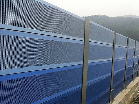 Blue noise barriers are installed on the highway.