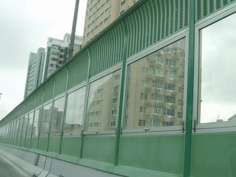 Louver noise barrier on the top, glass panel in the center and micro hole noise barrier on the bottom.