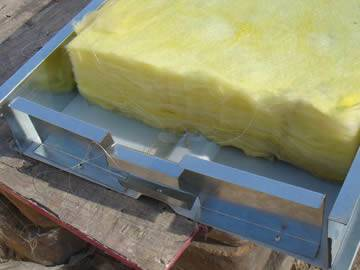Several pieces of glass wool are placed into the noise barrier.