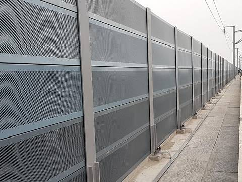 Micro hole noise barriers are installed on the railway.