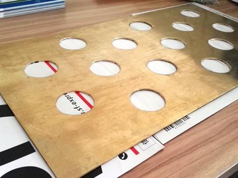 There is one single perforated brass sheet on the table, with fifteen perforated holes.