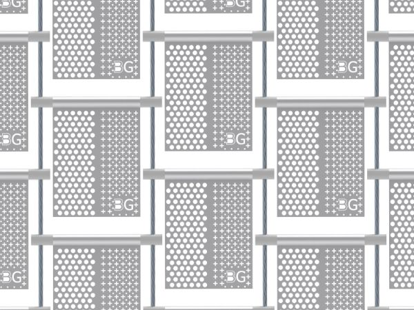 A piece of perforated kinetic facade with big round holes on the left, cross holes and small round on the right in staggered rows.