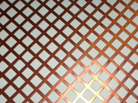 A piece of copper perforated plate sheet with square holes.