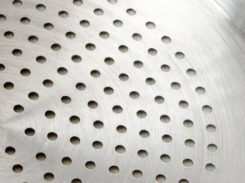 Perforated aluminum sheets with round holes are used as making cooks