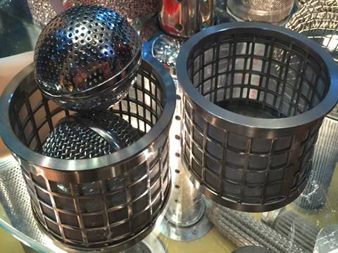 Many perforated filters with different hole size and hole patterns are placed together.