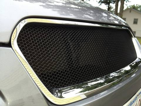 A black perforated mesh grill of a car made of hex hole perforated sheet
