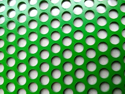A piece of green powder coating round hole perforated sheet.