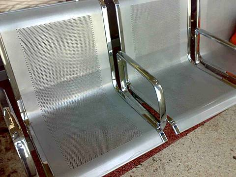 Metal chairs made of round hole perforated steel sheets