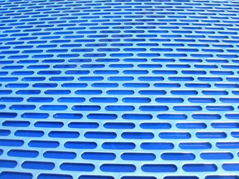 Cladding made of slot hole perforated sheets