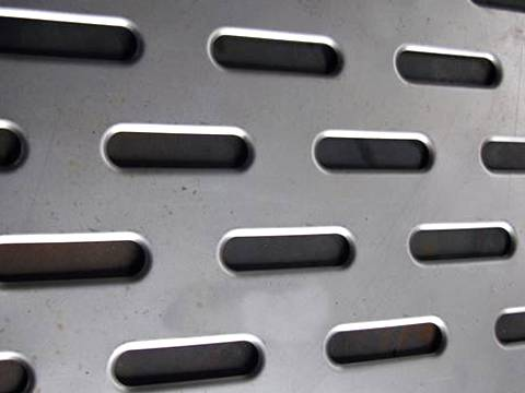 A perforated stainless steel sheets with staggered round end slot holes