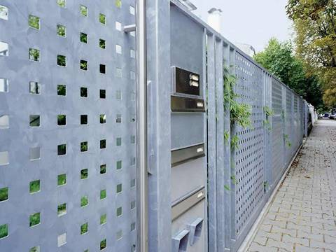 Metal fence which is made of perforated galvanized steel sheet with straight square holes